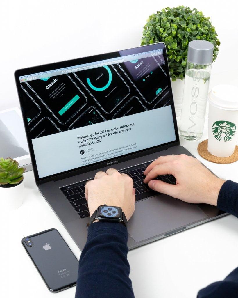 Guy blogging on laptop