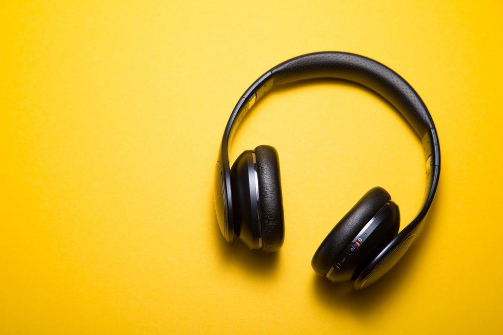 Black headphones on yellow desk