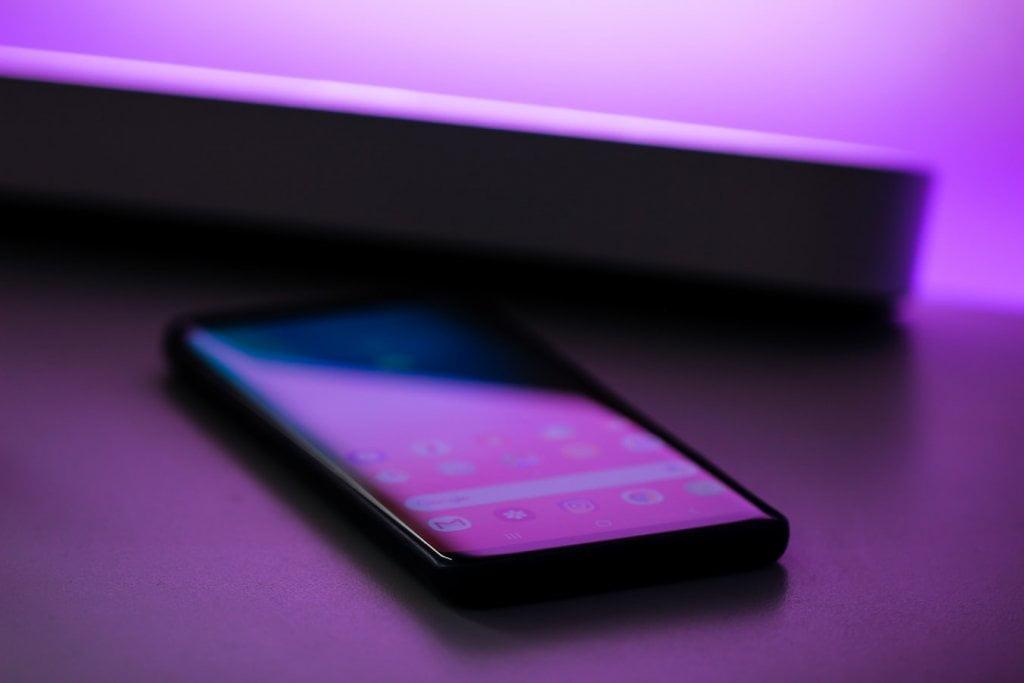 Phone on desk with glare