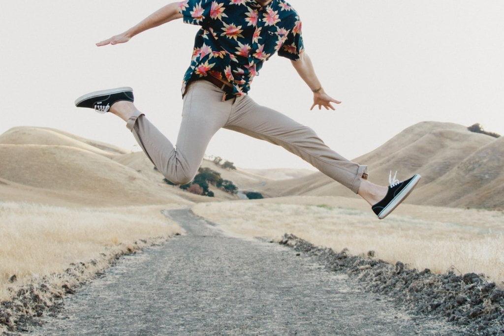 Man jumping and posing mid air