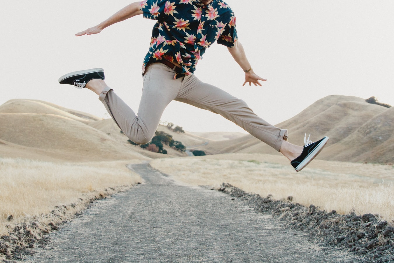 Man jumping and posing mid air