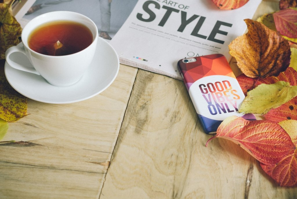 Tea on table with phone and book