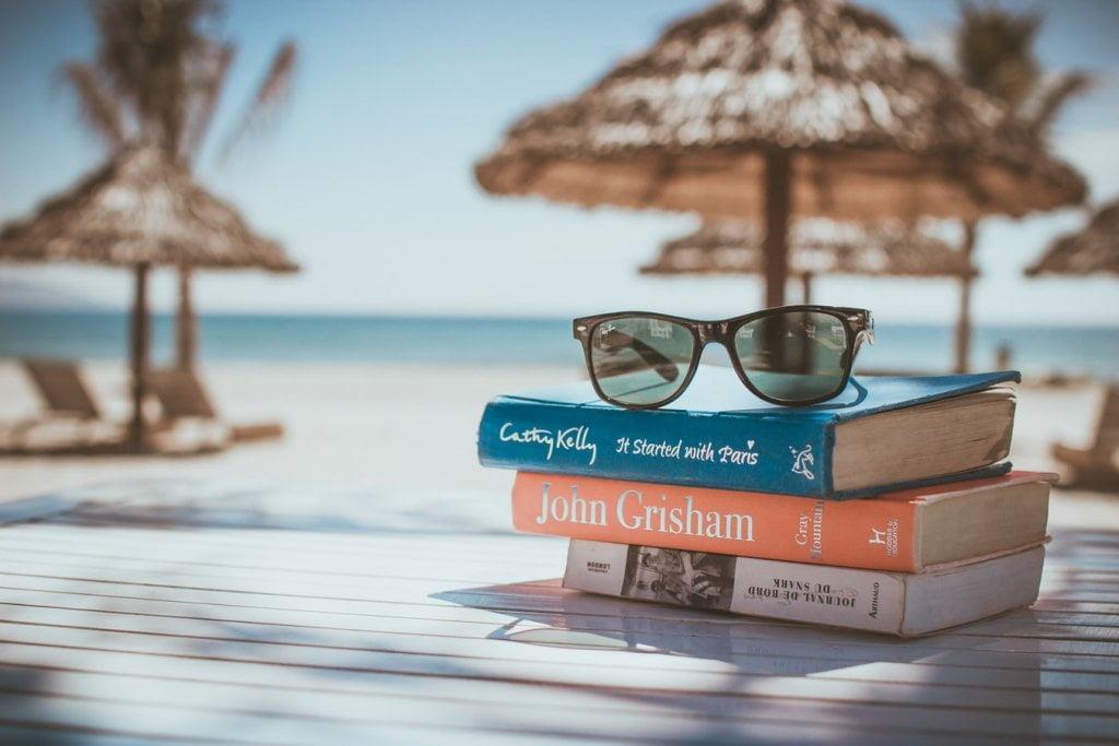 Books on table near the beach