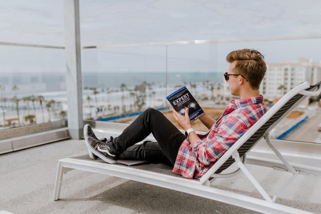 Reading a book on a chair