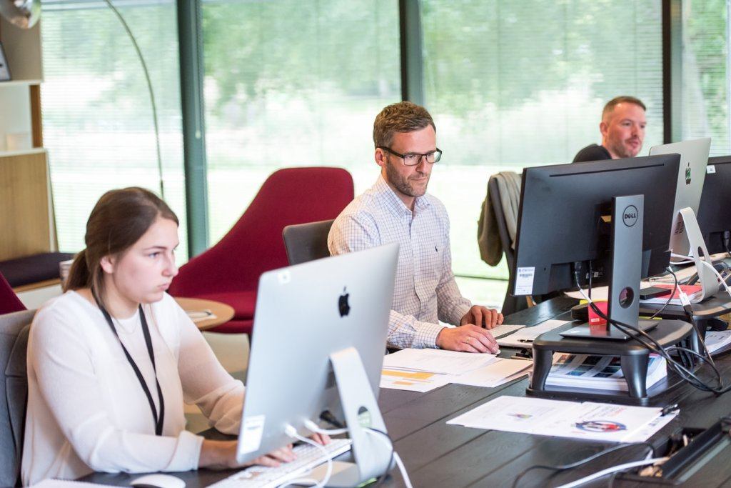 Three people working at startup