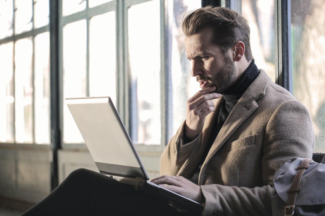 Man reading copywriting client questionnaire